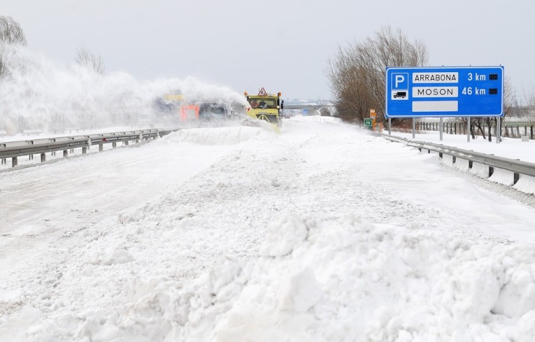 A snow plows clears the E75 motorway, nearby Gyor, Hungary. Large parts of Hungary had to deal with crippling snow, causing major transport problems and leaving thousands without electricity.