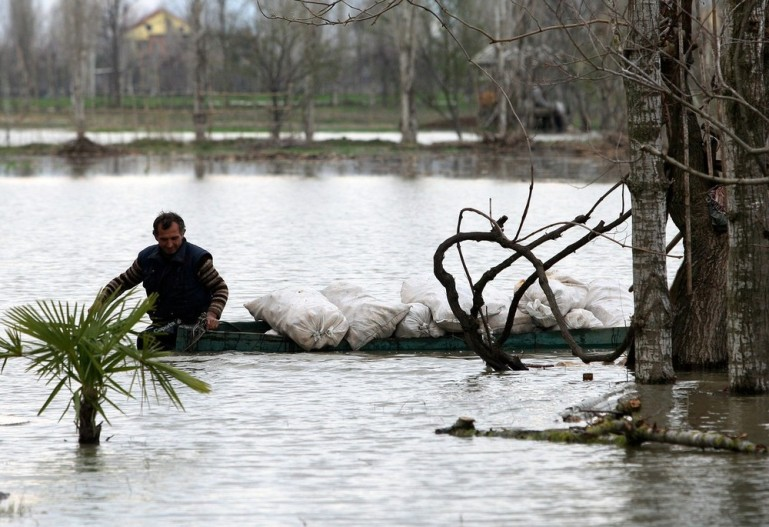 This man had to transport food for his cows by boat. Flooding in north and southern Albania has blocked roads, toppled a bridge and forced dozens of villagers to evacuate their homes.