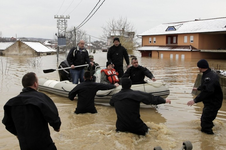 Members of the Kosovo Security Force rescued this woman whose house had been flooded. In another instance a 10 year old girl drowned when a river burst its banks in heavy rain.