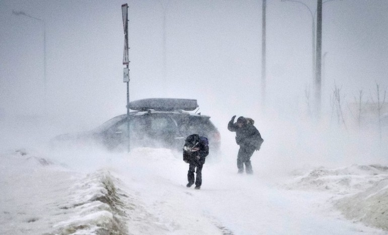 People struggled against wind and drifting snow in the Belarus capital Minsk.