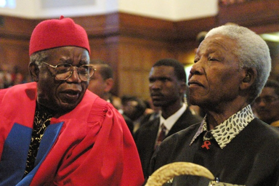 Achebe, left, with former South African President Nelson Mandela on September 12, 2002, prior to receiving an honorary degree at the University of Cape Town [Anna Zieminski/AFP]