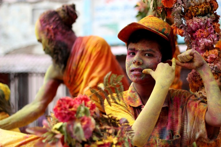 A boy poses like Krishna