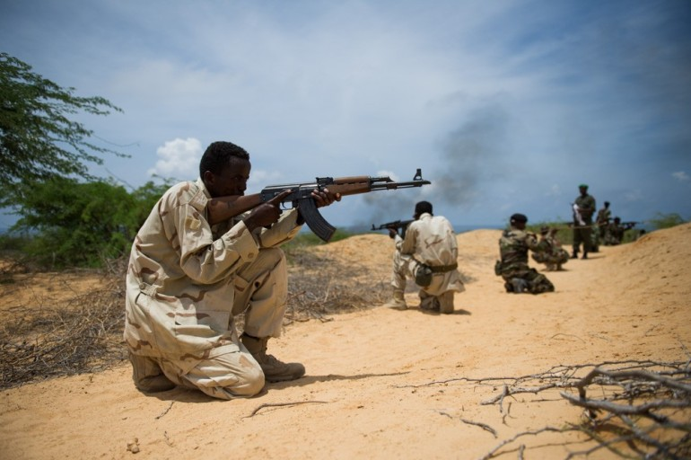 The Somali National Army (SNA), once little more than a militia, is becoming more professional and disciplined. Here, SNA recruits go through an assault drill during a training by SNA and AMISOM officers.