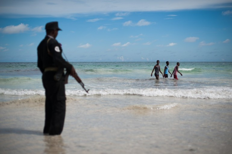 Bathers have returned to the warm waters of the Indian Ocean, but a famous beach-side cafe still requires private security. Bombs have rocked Mogadishu over the past year, and the Lido Seafood restaurant was targeted in February.