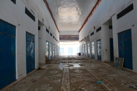 The town's main shopping mall has only eight shops open after more than 50 closed [Hamza Mohamed/Al Jazeera]