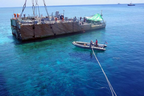 The USS Guardian was cut in to pieces during its removal after it struck the protected coral reef  [AFP]