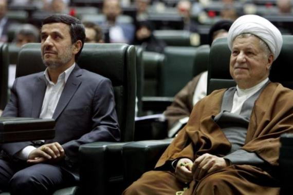 Former President Hashemi Rafsanjani (right) has been disqualified from running in the upcoming elections [AP]
