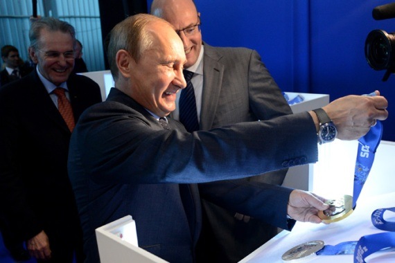 Putin faces criticism over allegations of costs overruns that have pushed the price tag for the Games to $50bn [EPA]
