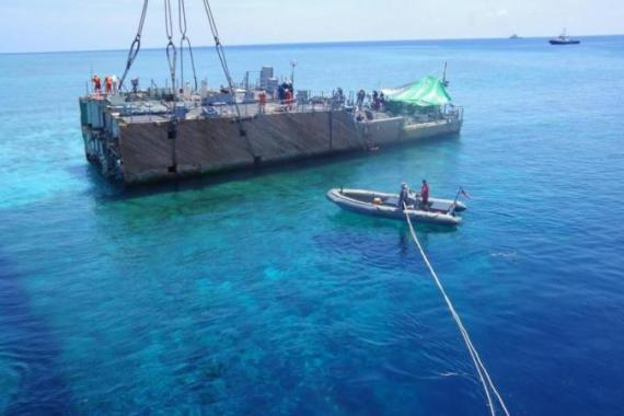 A US naval ship also ran into the UNESCO World Heritage-listed coral reef earlier this year [EPA]