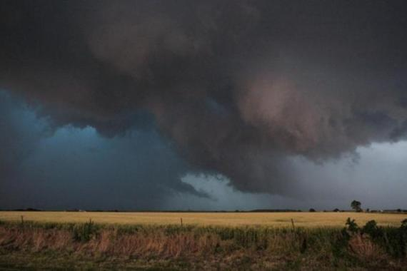 Large clouds filled the sky as the tornado passes south of El Reno in Oklahoma [Reuters]