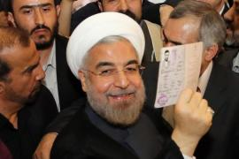 Hassan Rouhani won just over 50 percent of the vote, narrowly avoiding a runoff election [EPA]