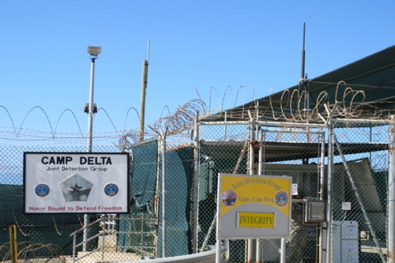 "The entrance to Camp Delta, which used to house all of the detention camps. This is where the detainee hospital and library are located. It was the sign that said the ""Value of the Week"" is ""Integrity"" that stood out amid the hunger strike [Jason Leopold/Al Jazeera]"