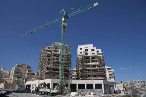 Jerusalem's planning commission issued building permits for 22 homes in two Palestinian-populated districts [AFP]