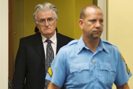 Karadzic has been charged with 11 counts of war crimes and genocide committed during the 1992-95 war [File: Michael Kooren/Reuters]