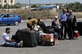 Palestinians wait at the Rafah crossing to enter Egypt from the Gaza Strip as the border reopened on July 10  [AP]