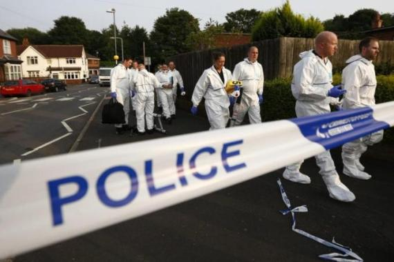 Police investigate a suspected nail bomb attack on a mosque after an explosion in Tipton, central England, July 12 [Reuters]