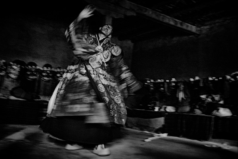 Festival dancers prepare to perform unique dances that focus on the victory over evil at the Shachukul Monastery.