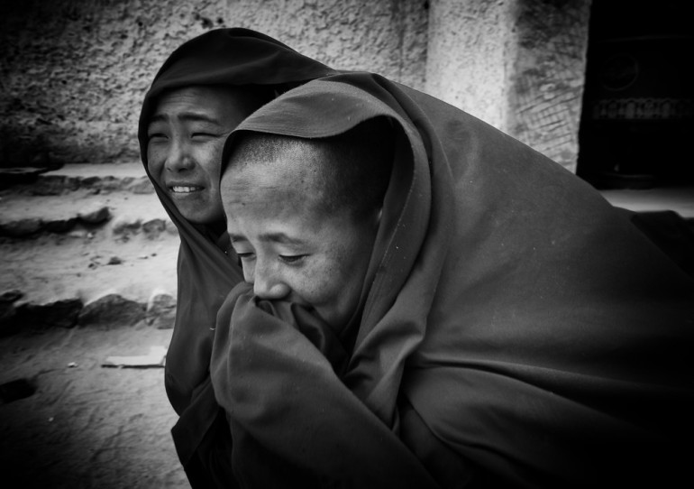 Monks run for shelter upon the outbreak of a sudden windstorm in Chumathang, Ladakh.
