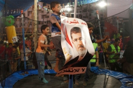 Children supporters of deposed president Mohamed Morsi jump on a trampoline in a makeshift fair [Reuters]
