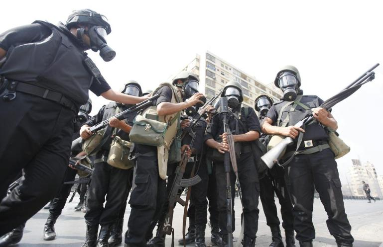 Riot police gather during clashes with members of the Muslim Brotherhood around Cairo University and Nahdet Misr Square in Giza.
