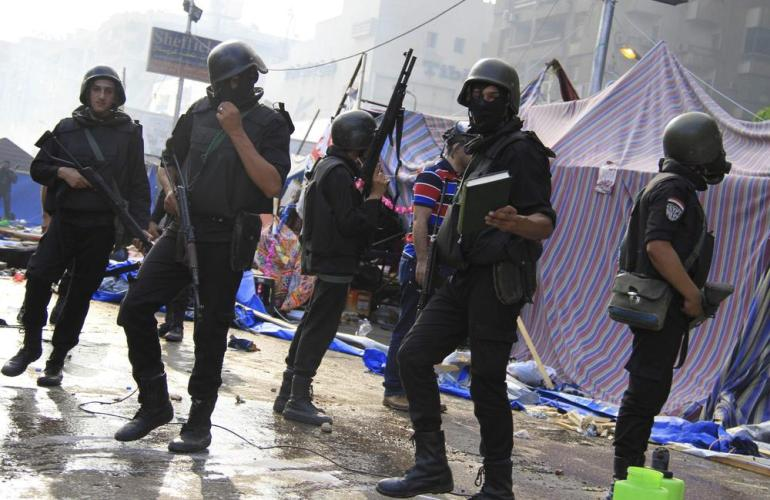 Riot police attempt to clear the Rabaa al-Adawiya area of members of the Muslim Brotherhood.