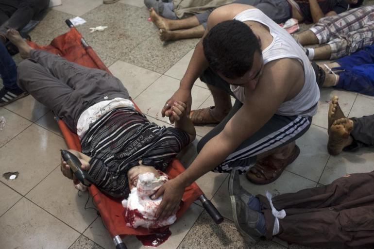 <p>A pro-Morsi supporter cries over the body of his slain friend at a field hospital inside the Rabaah al-Adawiya protest camp in Nasr City, Egypt during Wednesday(***)s operation to break-up demonstrations. </p>