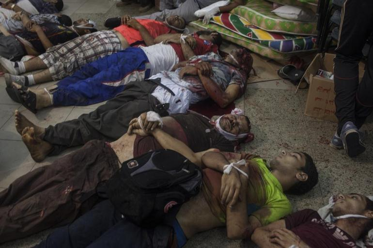 The bodies of at least nine pro-Morsi supporters lie on a floor at a field hospital inside the Rabaah al-Adawiya protest camp.