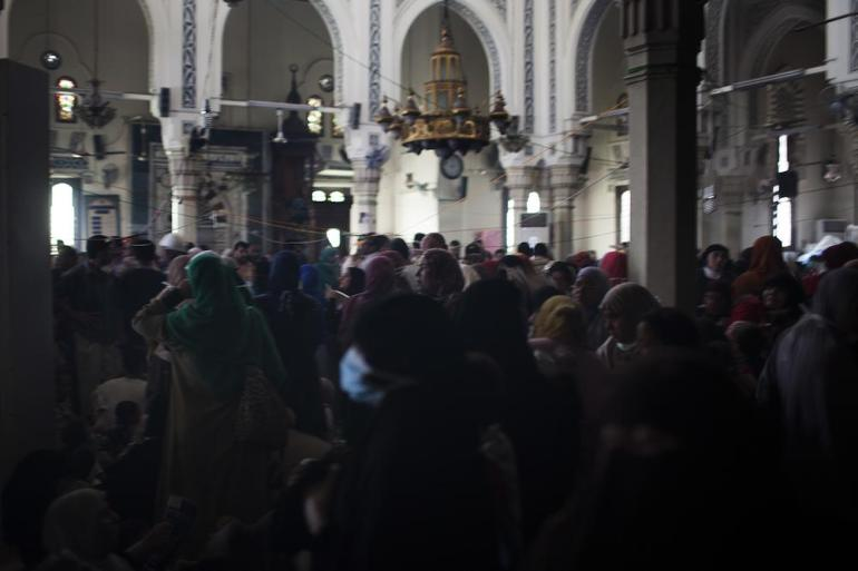 Women and children pro-Morsi supporters take refuge inside the Rabaah al-Adawiya mosque within the larger protest camp.