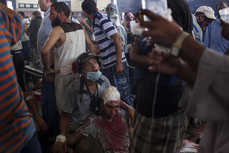 An injured pro-Morsi supporter is a given first aid at a field hospital.