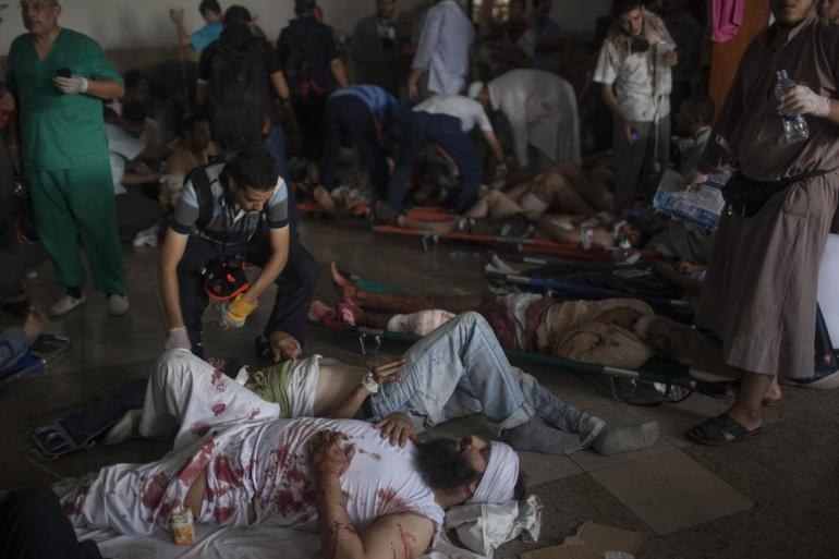 Injured pro-Morsi supporters are treated at a field hospital.