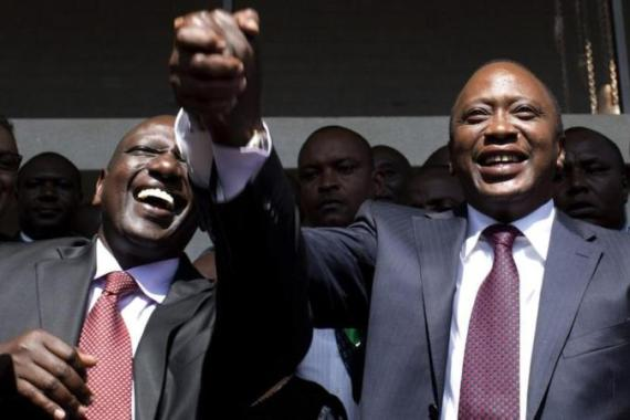 Kenyatta, right, greets supporters with his running mate Ruto after a news conference in 2013 - now the president and his deputy are at odds [Reuters]
