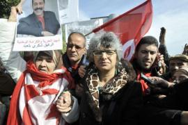 Basma Khalfaoui, centre, wife of Chokri Belaid, is receiving similar threats to those made against her husband [AFP]