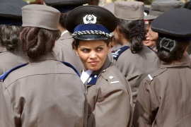 A policewoman and female members of the Afghan Police Academy at a ceremony in Kabul in 2002 [AP]