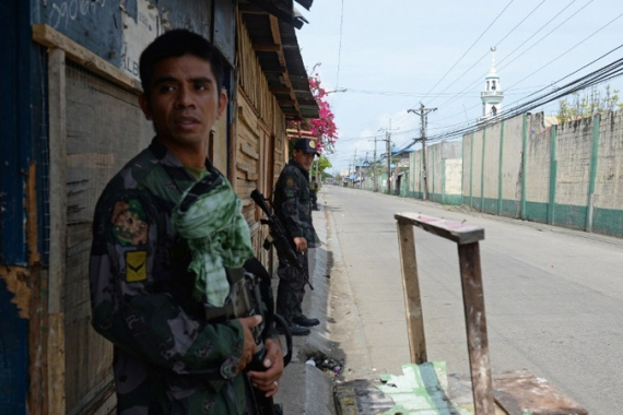 Unrest continues as a standoff between rebels and Philippine military engulfs the city of Zamboanga in fighting[AFP]