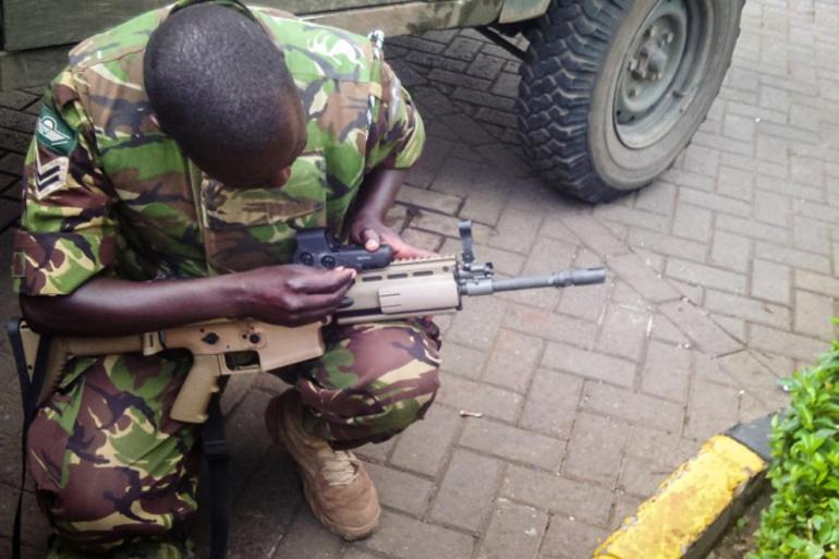 A soldier prepares his kit before an assault on Al Shabab militants by the Kenyan military. The attackers from the Somalia-based group had barricaded themselves in a shopping centre and were suspected to have explosives.
