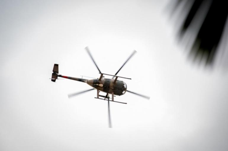 A military helicopter flies in low circles, as soldiers move in to the Westgate shopping centre.