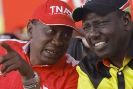 Uhuru Kenyatta and his deputy William Ruto, right, have lobbied to have their trial suspended [EPA]