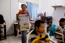 The Timor Post newspaper reports in Tetum, Portuguese, and English [Pei Ting Wong/Al Jazeera]