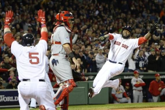 Early lead: Boston's David Ortiz scores on batter Mike Napoli's three-run double in the first inning [EPA]