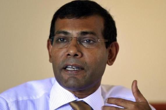 """Nasheed's journey from a Maldivian torture cell to global statesman is the stuff movies are made of,"" write Lykke Friis and Anders Henriksen.  [AP]"