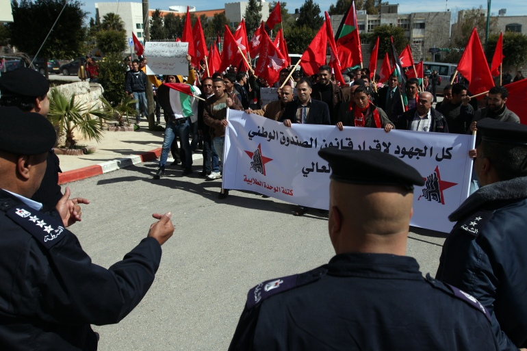 Students from Birzeit University protest high costs in front of the Prime Minister's Office [EPA]