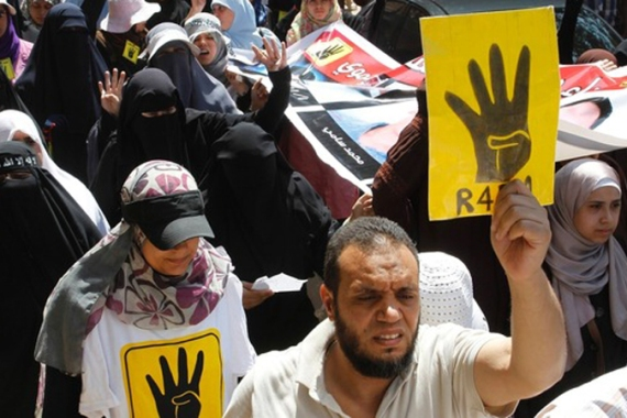 "The four finger salute is ""among the most feared symbols after the July 3 coup"", writes Larbi Sadiki [Reuters]"