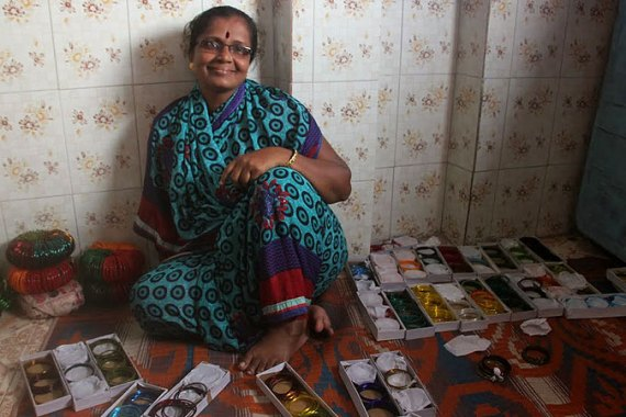 Kalpana Shinde runs a small business in bangles and saris from her Dharavi home [Asad Hussain/Al Jazeera]