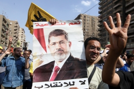 Ousted president Mohamed Morsi is to be tried along with 14 other defendants on Monday [EPA]