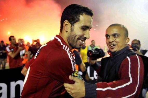 Aboutrika is embraced after putting the seal on a spectacular career in African football [AP]