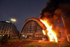 A rainbow installation in Warsaw symbolizing diversity was set on fire by far-right demonstrators [Reuters]