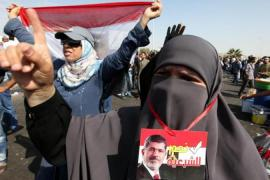 The coup of July 3 and the trial of Mohamed Morsi has led to deep divisions in the Egyptian public [EPA]