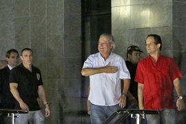 Jose Dirceu, former chief of staff to President Lula, turned himself in to start seven-year sentence [AFP]