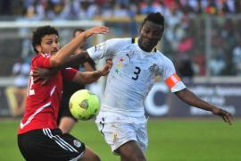 Black Stars captain Gyan, right, says Ghana will be composed but not relaxed against Egypt [AP]