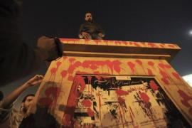 A hastily installed memorial in Tahrir Square was quickly defaced and destroyed [Reuters]